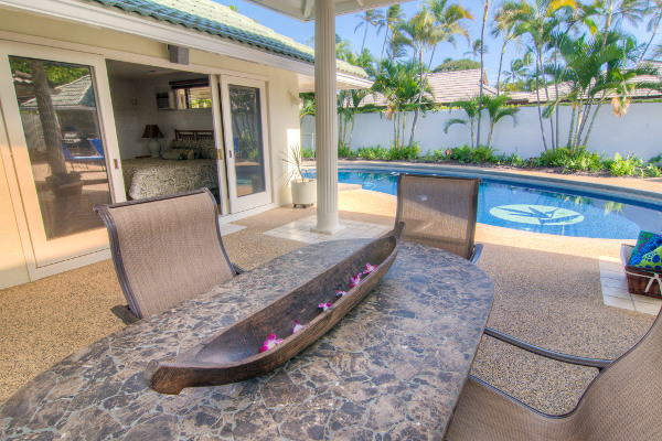 Lanai dining table by pool